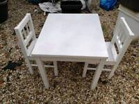 White wooden chiidrens table / chairs