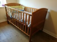 Height adjustable cot bed