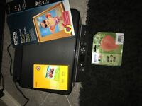 Epson printer, photo paper and 2 new cartridges.