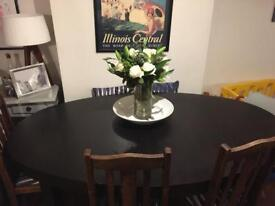 Extending oval table seats 6/10