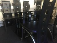 Glass dining table with six chairs for sale