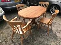 Solid pine dining room table and 4 chairs, cost £600 ideal for painting duck egg blue or cream etc