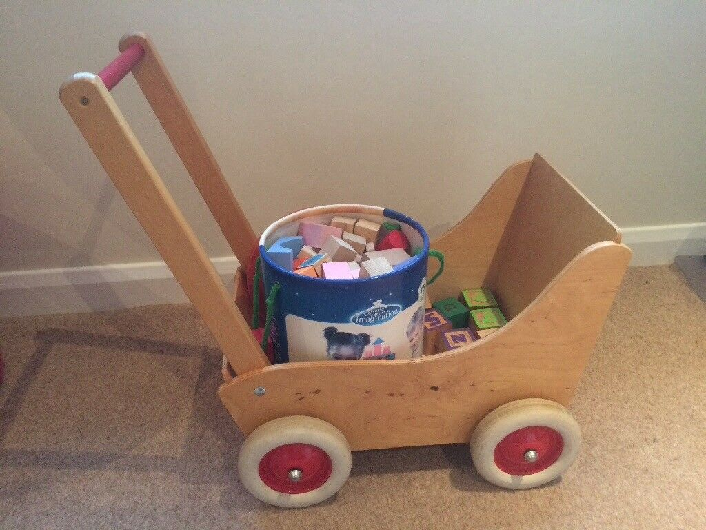 Wooden toddler cart with large bucket of shaped wooden blocks