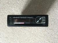 Pioneer DEH-1700UB Single DIN car radio with a Double DIN adapter