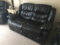 Brown leather reclining sofa. Like new!