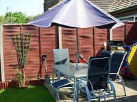 GLASS GARDEN TABLE AND 6 RECLINING CHAIRS + 2 FOOTSTOOLS GREY/BLUE £85.00 ONO