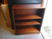 Dark coloured wood 3 shelved bookcase