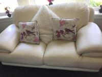 Cream leather 2/3 seater sofa/couch and generously sized Armchair.