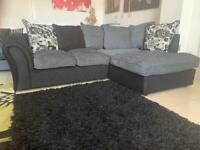 Ex Display Black Leather and Grey Fabric Corner Sofa