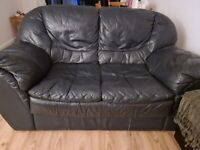 2x Black Leather Sofas in Good Condition