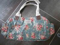Handbag, brand new, floral PVC with pockets