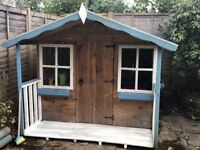 Wooden playhouse 8ft x 6ft (including wooden easel and play table/chairs)
