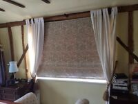 Linen curtain drapes to the floor