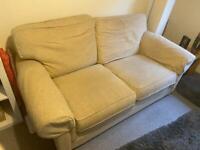 Large 2 seater sofa cream good condition