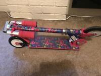 Girls folding Hello Kitty scooter