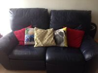 Navy leather reclining 2 seater sofa.