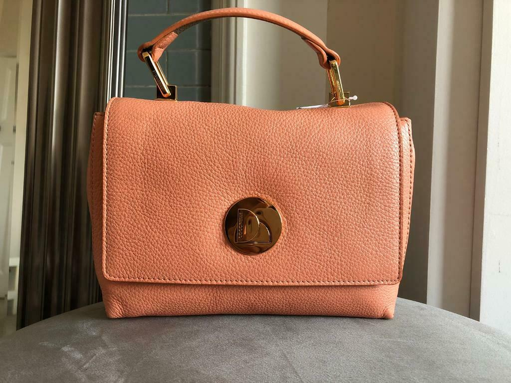 72946cc46 Coccinelle Liya Mini Leather Handbag Salmon Pink | in Ealing ...