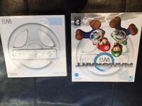 Hardly Used Wii Console with 2 remotes, 2numchuks, 2 wheels, wii fit with balance board and games