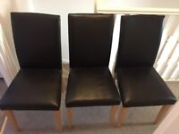 3x brown faux leather dining chairs