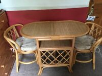Bamboo table and chairs with seat pads, excellent condition. Ideal if you have limited space.