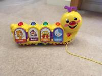 Fisher price pull along caterpillar, as new