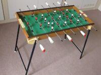 "Table Football game. Folding legs, four footballs, 30"" x 18"" x 26"" high"