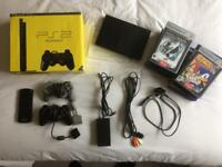 PlayStation 2 with extras. Great condition.