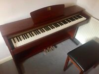 Yamaha Clavinova Piano CLP 320M, barely used, comes with Piano stool.