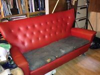 Red retro three seat sofa Needs work on cushions and supports Industrial casters fitted