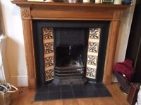 Immaculate genuine cast iron Victorian fireplace with grate, back and intact beautiful tiles.