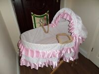 Pink frilly satin moses basket and stand