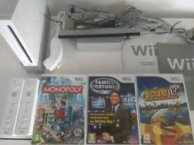 Nintendo Wii console, two controllers and three games