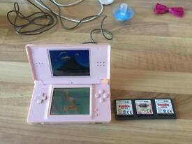 Nintendo ds lite in pink with games