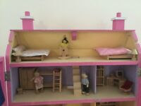 Wooden 4 storey dolls house with lots of furniture and people. See photos for details of inclusions