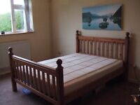 Excellent king sized pine bed frame for a 5 ' mattress.