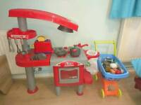 Toy play kitchen, toaster, trolley, food