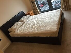 King sized faux leather ottoman bed