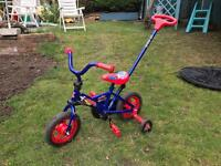 """10"""" space ranger bike with stabilisers and steering bar"""