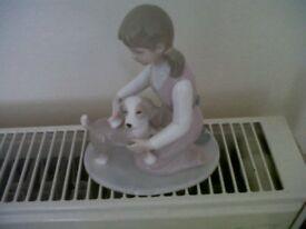 Little Girl who is Grooming her Puppy - Annie Rowe for The Leonado Collection.