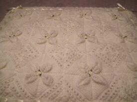 Hand knitted baby pram cover