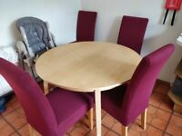 Extending kitchen dining table with 4 chairs.