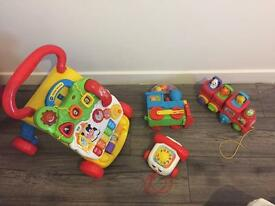 V tech baby Walker and a few extra toys, batteries included