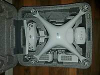 DJI Phantom 4 with 4 batterys max 20 flights perfect condition with 7 months warranty.