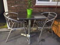 Outdoor table and 2 chairs to collect in Archway