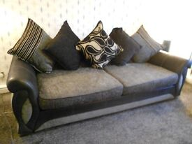 large four seater grey and black sofa plus storage footstool only 11 month old