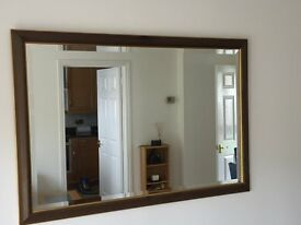 Wooden framed bevelled edged mirror in very good condition.