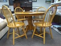 Solid oak table and hard wood chairs