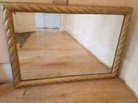 Big wooden gold framed swirl mirror