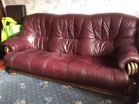 Burgandy sofa with matching armchairs