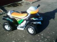 Battery operated quad bike with charger